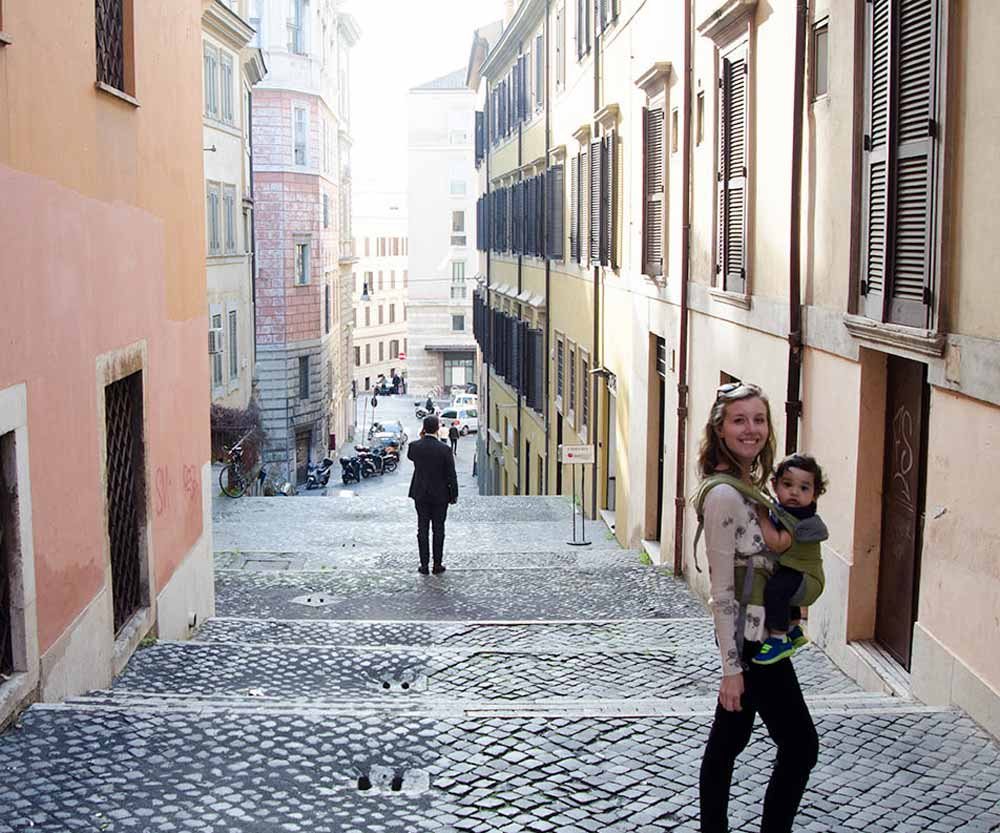 Mother and baby in carrier on street in Rome Italy