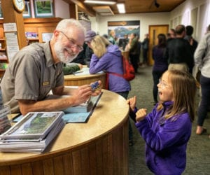Girl getting exciting while receiving Free National Park Pass for 4th Graders