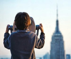 boy-looking-at-the-empire-state-building-1000