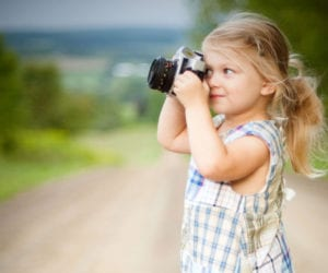 girl-child-camera-family-vacation-planning-1000
