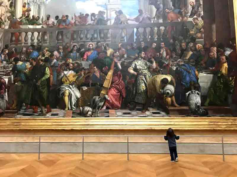 Boy admiring art at The Louvre-Paris. 5-day itinerary in Paris with kids