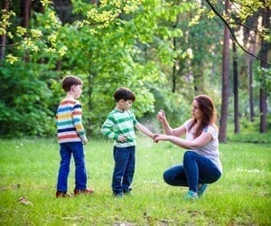 mom applying insect repellant