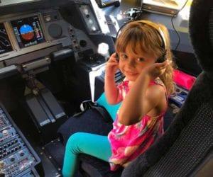 Hawaiin Airlines girl acting like pilot. best U.S airlines children.