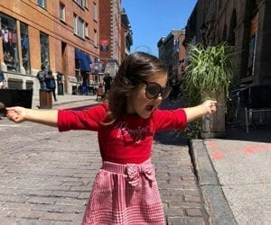 little girl on the Montreal street dancing