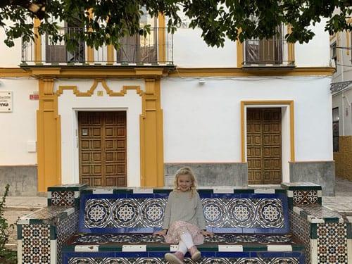 Girl-on-a-bench-seville-Spain2