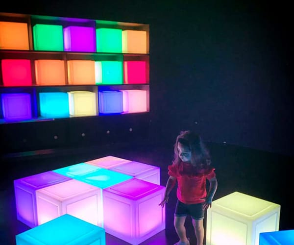 Young girl in front of colorful cubes in Singapore